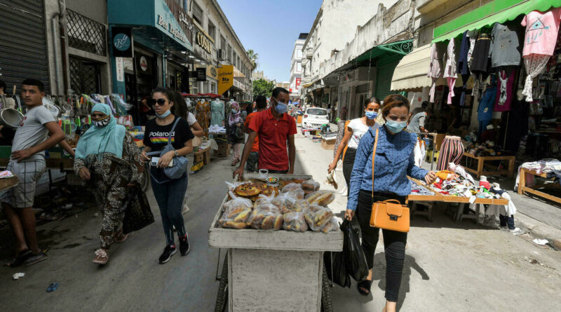 """In Tunis cafes, cynicism saps opposition to the president's """"power grab"""